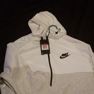 Grey and white Nike zip up. Mens large,never worn